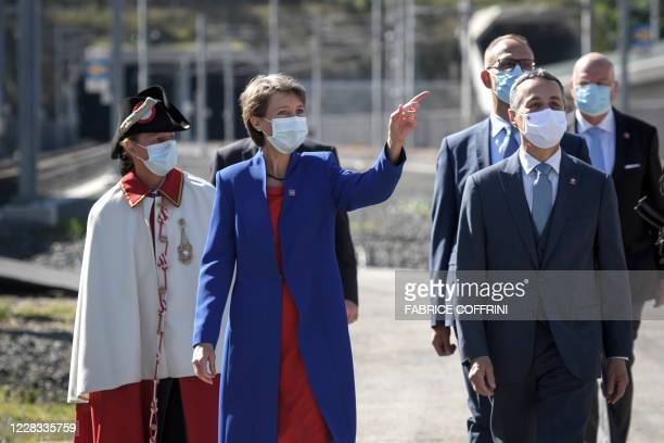 Swiss President Simonetta Sommaruga wearing a protective face mask gestures next to Swiss Foreign Minister Ignazio Cassis on September 4 in Camorino,...