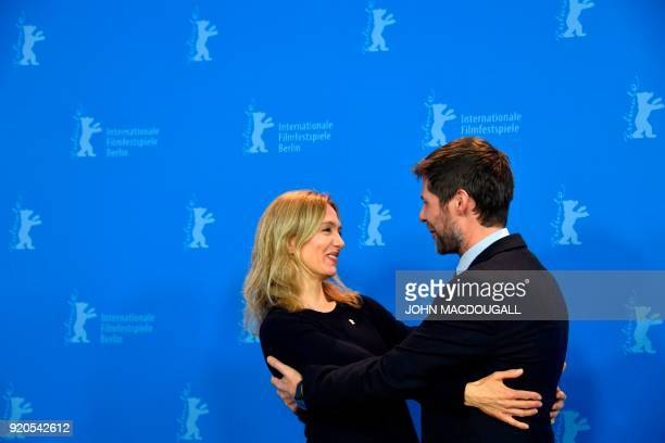 Swiss Producer Lionel Baier and Swiss actres Ursina Lardi hug during a photo call for the film 'Shock Waves Diary of My Mind' presented in in the...