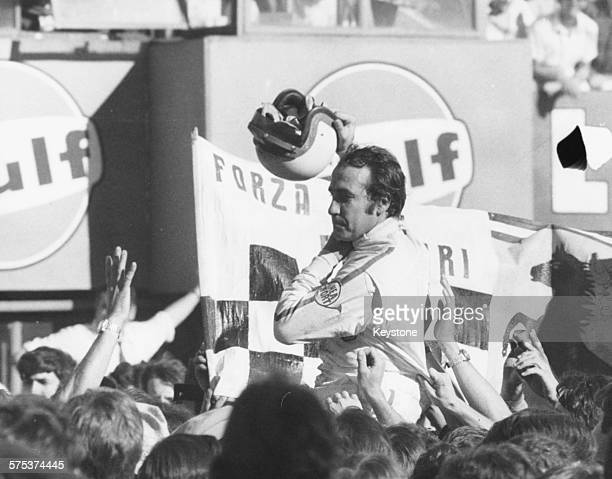 Swiss racing driver Clay Regazzoni is grabbed by members of the crowd after winning the Italian Grad Prix at Monza September 8th 1970