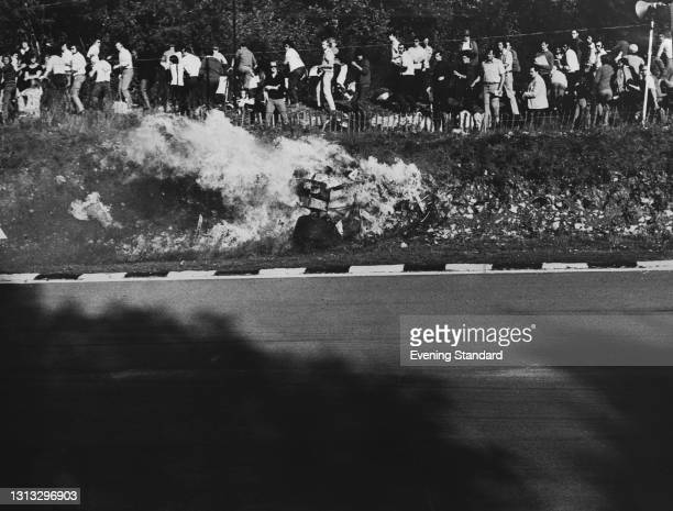 Swiss racing driver Jo Siffert is killed when his car catches fire after a crash in the 1971 World Championship Victory Race at Brands Hatch, UK,...