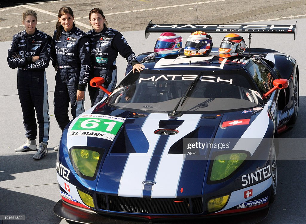 Swiss Rahel Frey, Natacha Gaghnang, and their compatriot Cyndie Allemann pose next to their Ford GT N° 61 on June 6, 2010 in Le Mans, western France during the competitors' scrutineering. Fifty-six cars with 168 drivers will participate on June 12 and 13 in the 78th edition of the Le 24-hour endurance race.