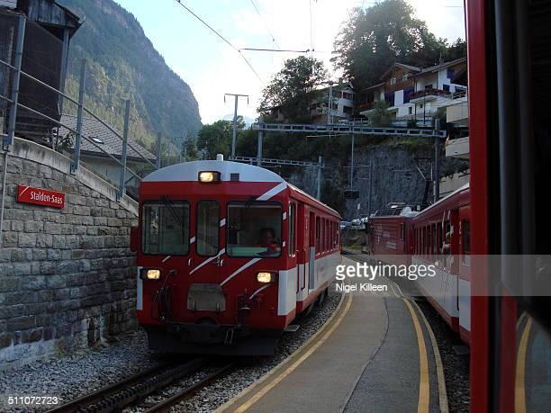Swiss Railways SBBCFFFFS trains passing through Stalden Train Station Switzerland