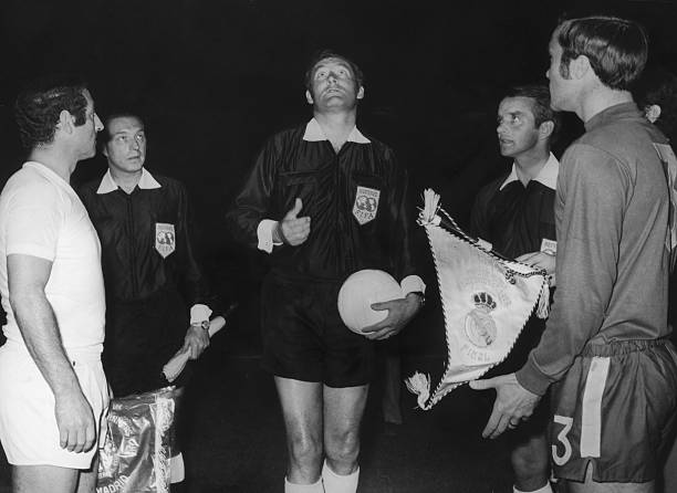 Swiss referee Rudolf Scheurer flips the coin before the UEFA Cup Winners' Cup final between Chelsea and Real Madrid at the Karaiskakis Stadium,...