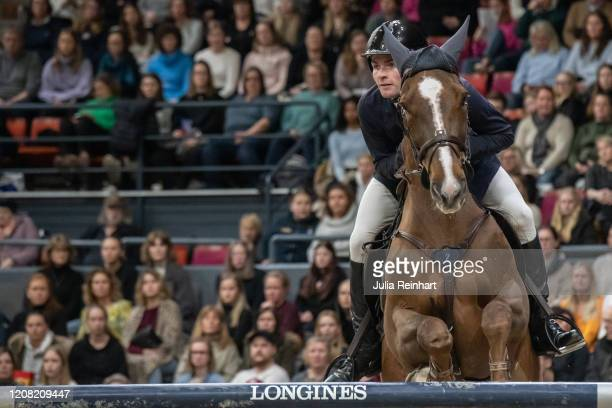 Swiss rider Bryan Balsiger on Twentytwo Des Biches competes in the FEI World Cup Jumping event during the Gothenburg Horse Show at Scandinavium Arena...
