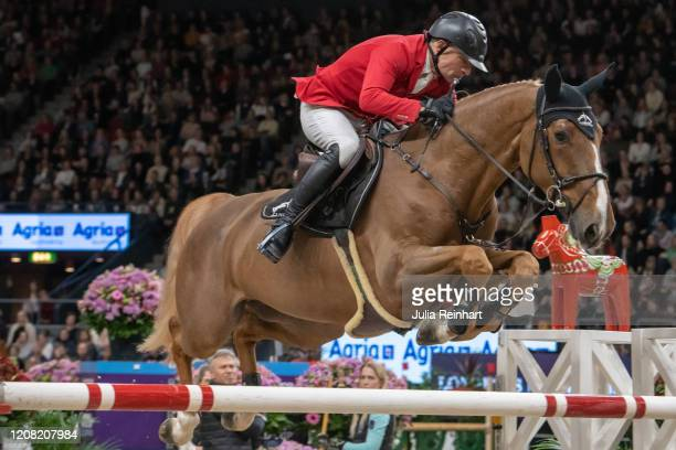 Swiss rider Paul Schwizer on Vient Tu du Rouet competes in the FEI World Cup Jumping event during the Gothenburg Horse Show at Scandinavium Arena on...