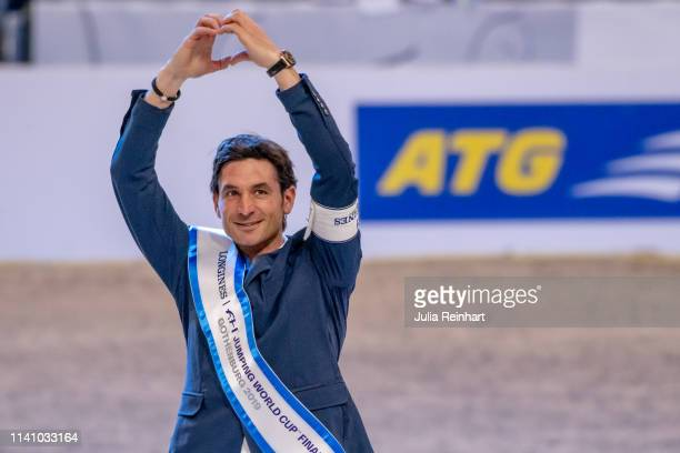Swiss rider Steve Guerdat celebrates his victory during the price giving ceremony for the 2019 Longines FEI Jumping World Cup Final during the...