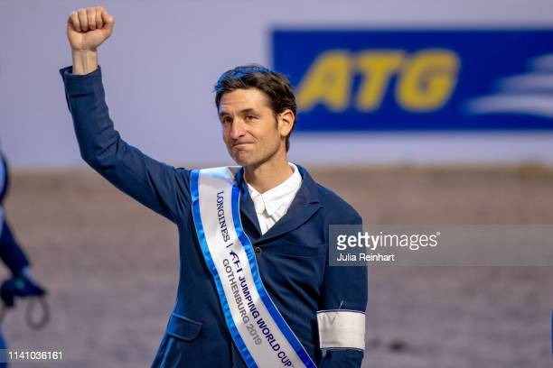 Swiss rider Steve Guerdat gets emotional as he celebrates his victory during the price giving ceremony for the 2019 Longines FEI Jumping World Cup...