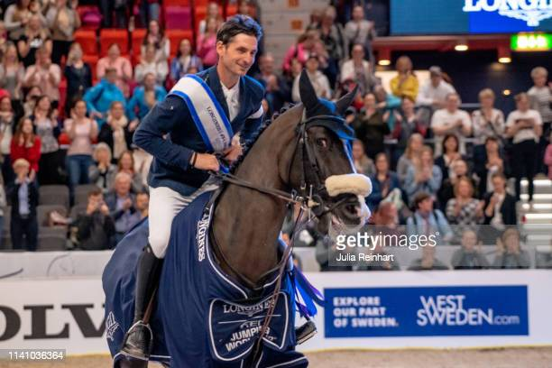 Swiss rider Steve Guerdat on Alamo celebrates his victory during the price giving ceremony for the 2019 Longines FEI Jumping World Cup Final during...