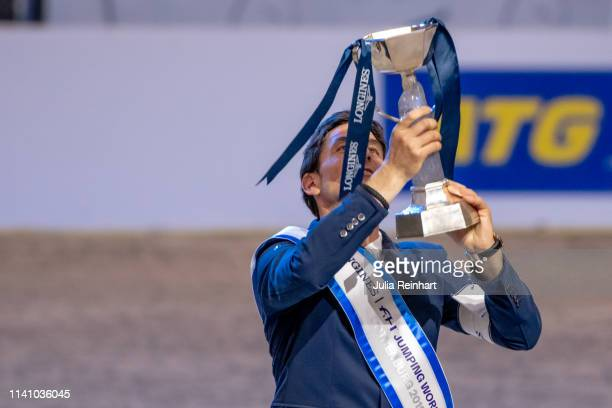 Swiss rider Steve Guerdat show off his winners' trophy during the price giving ceremony for the 2019 Longines FEI Jumping World Cup Final during the...