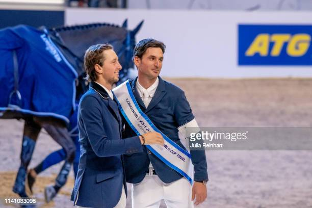 Swiss riders Martin Fuchs and Steve Guerdat celebrate during the price giving ceremony for the 2019 Longines FEI Jumping World Cup Final during the...