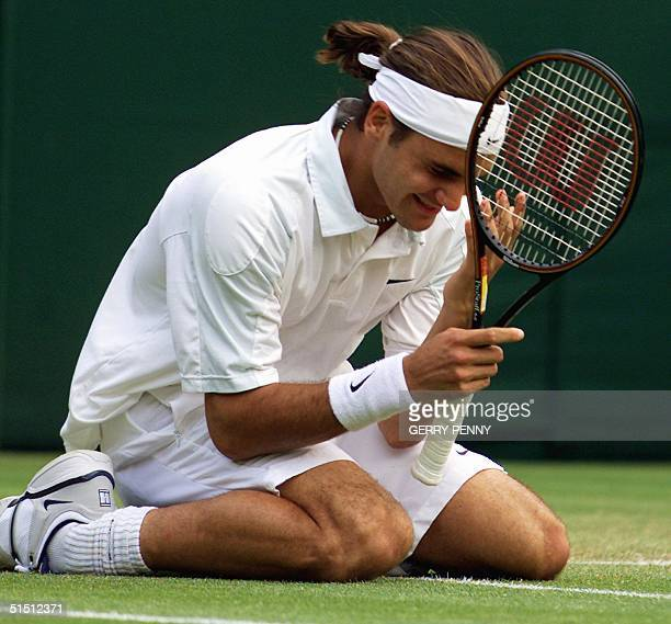 Swiss Roger Federer celebrates after winning his fourth round match against US player Pete Sampras at the All England Tennis Championships in...