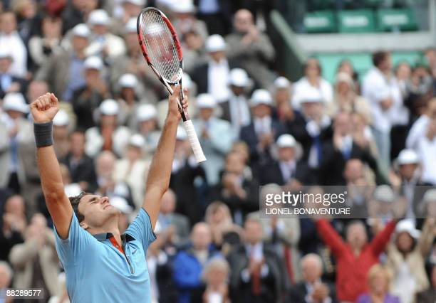 Swiss Roger Federer jubilates after winning against Swedish player Robin Soderling during their French Open tennis men's final match on June 7 2009...