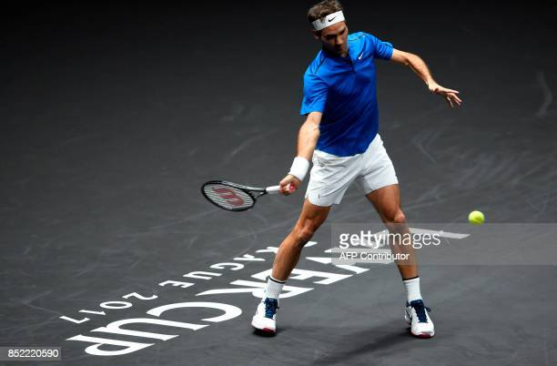 Swiss Roger Federer of Team Europe returns the ball to US Sam Querrey of Team World during second day of Laver Cup on September 23 2017 in O2 Arena...