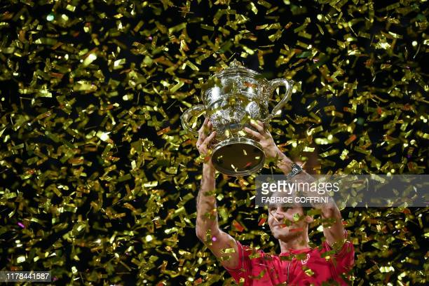 Swiss Roger Federer raises the trophy after his 10th victory at the Swiss Indoors tennis tournament in Basel on October 27, 2019.