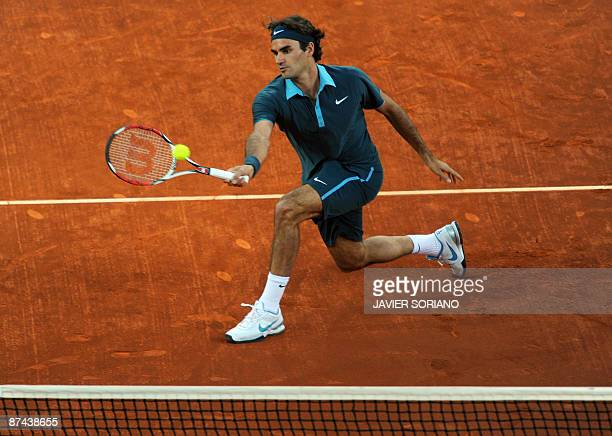 Swiss Roger Federer returns a ball against Argentinian Juan Martin del Potro during their semi final match of the ATP Madrid Open claycourt...