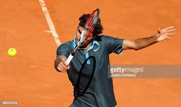 Swiss Roger Federer returns a ball against Spanish Rafael Nadal during their final match of the ATP Madrid Open claycourt tournament on May 17 2009...