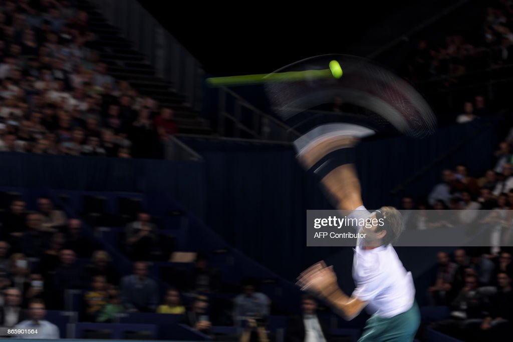 Swiss Roger Federer returns a ball during his tennis match against US Frances Tiafoe at the Swiss Indoors ATP 500 tennis tournament on October 24, 2017 in Basel. / AFP PHOTO / Fabrice COFFRINI