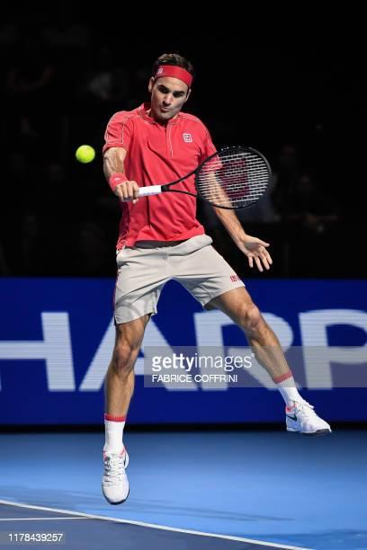 Swiss Roger Federer returns a ball to Australian Alex De Minaur during their final match at the Swiss Indoors tennis tournament in Basel on October...