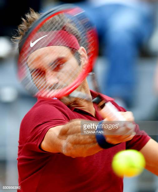 Swiss Roger Federer returns the ball to Austrian Dominic Thiem during the ATP Tennis Open tournament at the Foro Italico, on May 12, 2016 in Rome. /...