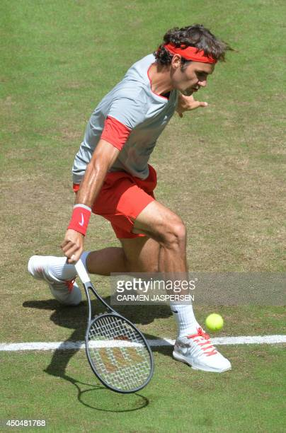 Swiss Roger Federer returns the ball to Portuguese Joao Sousa during the ATP Gerry Weber Open tennis tournament in Halle western Germany on June 12...