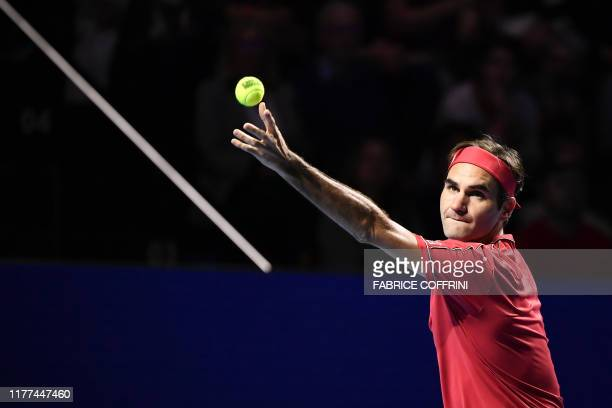 TOPSHOT Swiss Roger Federer serves a ball against German Peter Gojowczyk during the 1500th match of his career at the opening day of the Swiss...