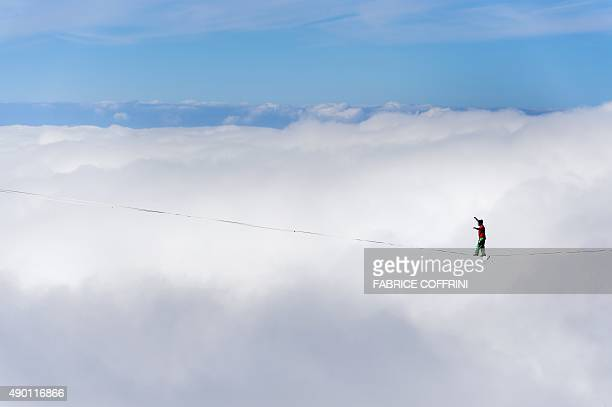 Swiss Samuel Volery walking the line during the Highline Extreme event in Moleson peak western Switzerland on September 26 2015 Fifty of the European...