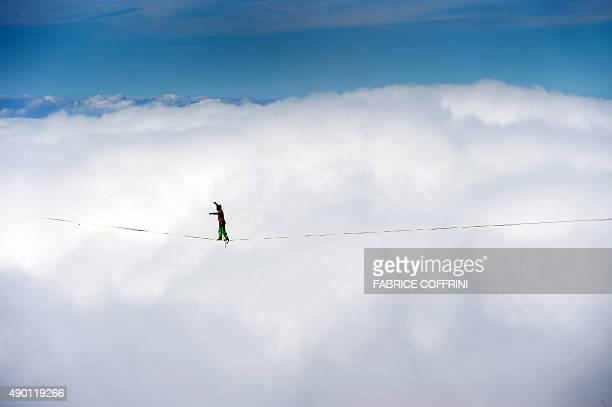 Swiss' Samuel Volery walks on the line during the Highline Extreme event in Moleson peak western Switzerland on September 26 2015 Fifty of the...