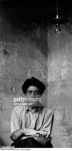 Swiss sculptor Alberto Giacometti poses for portrait in his studio May 12 1954 in Paris France