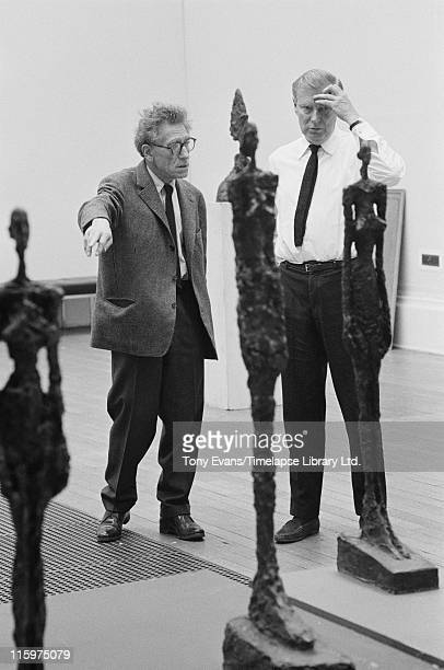 Swiss sculptor and painter Alberto Giacometti and Robin Campbell with some of Giacometti's work at the Tate Gallery London July 1965