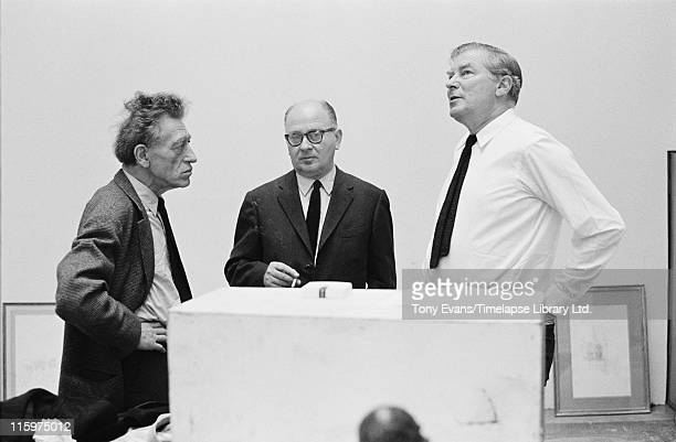 Swiss sculptor and painter Alberto Giacometti at the Tate Gallery London July 1965 With him are his friend Louis Clayeux and Robin Campbell