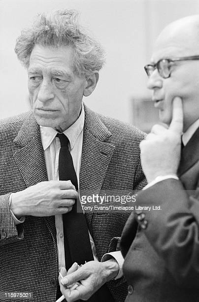 Swiss sculptor and painter Alberto Giacometti at the Tate Gallery London with his friend Louis Clayeux July 1965