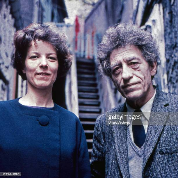 Swiss sculptor, painter and graphic artist Alberto Giacometti with Annette Arm at his studio in Paris, France 1962.