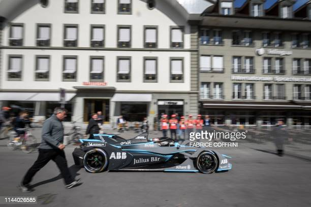 Swiss Sebastien Buemi drives his car in the city street during a promotion event of the Swiss stage of the Formula E electric car championship on May...