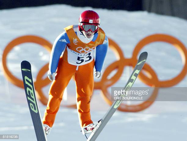 Swiss Simon Ammann is airborne during the individual skijumping K90 first round of the Salt Lake 2002 Olympic Winter Games at the Utah Olympic Park...