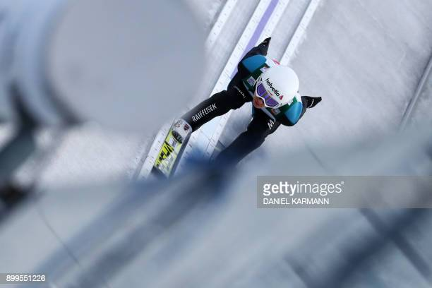 Swiss Simon Ammann soars through the air during his training jump ahead of the ski jumping event in Oberstdorf, southern Germany, which is the first...