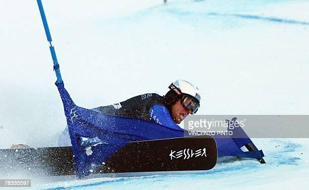 Swiss Simon Schoch falls in the Men's parallel giant slalom snowboard World Cup race in Limone Piemonte 08 December 2007 Austrian Manuel Veith won...