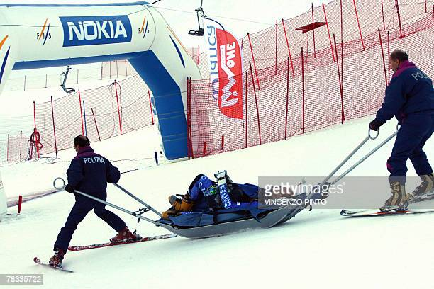 Swiss Simon Schoch leaves the race on a stretcher after being injured in the Men's parallel giant slalom snowboard World Cup race in Limone Piemonte...