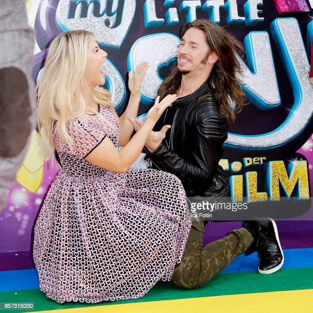 Swiss singer Beatrice Egli and German singer Gil Ofarim attend the 'My little Pony' Premiere at Zoo Palast on October 3 2017 in Berlin Germany