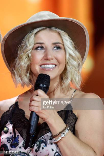Swiss singer Beatrice Egli performs during the television show 'Willkommen bei Carmen Nebel' at Velodrom on May 4 2019 in Berlin Germany