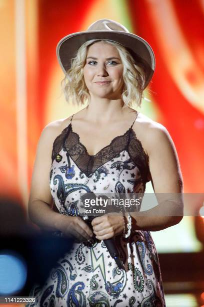 Swiss singer Beatrice Egli performs onstage during the television show 'Willkommen bei Carmen Nebel' at Velodrom on May 4 2019 in Berlin Germany