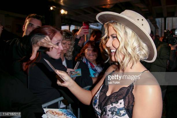 Swiss singer Beatrice Egli with fans during the television show 'Willkommen bei Carmen Nebel' at Velodrom on May 4 2019 in Berlin Germany