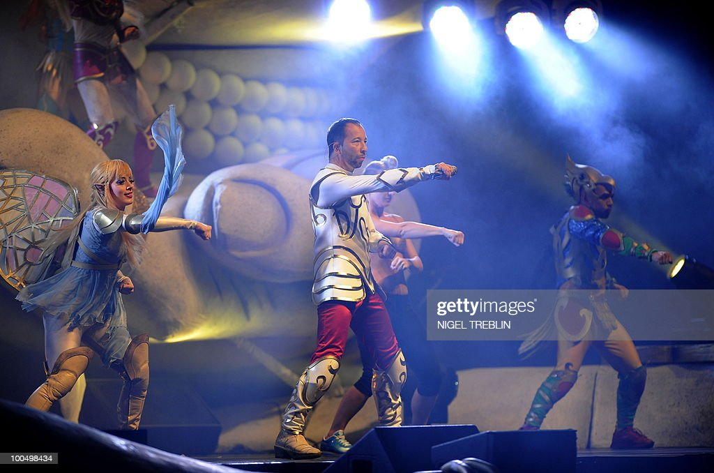 Swiss singer, dancer and music producer DJ BoBo (C) performs on stage during a concert on May 24, 2010 in Bremen, northern Germany. DJ BoBo actually tours Germany with his 'Fantasy Tour'.