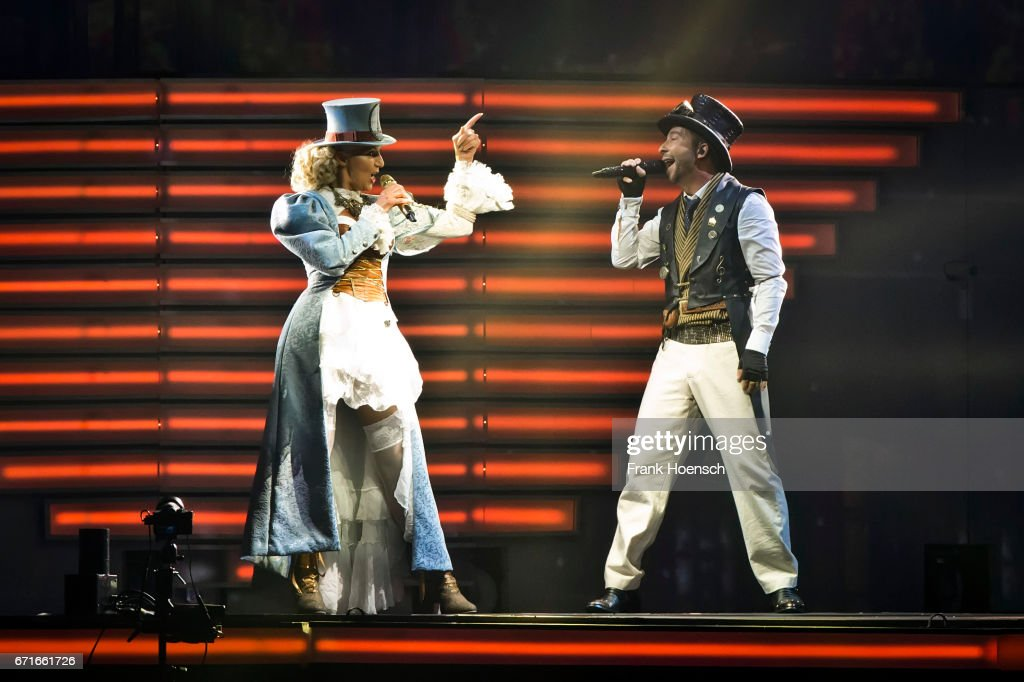 Swiss singer DJ Bobo (R) performs with his wife Nancy Baumann live during a concert at the Mercedes-Benz Arena on April 22, 2017 in Berlin, Germany.