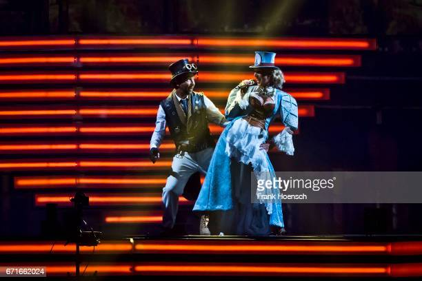 Swiss singer DJ Bobo performs with his wife Nancy Baumann live during a concert at the MercedesBenz Arena on April 22 2017 in Berlin Germany