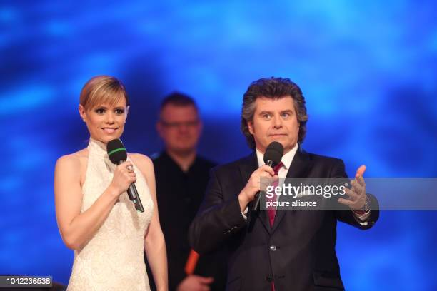 Swiss singer Francine Jordi and Austrian presenter and singer Andy Borg perform during the dress rehearsal for the television music show...