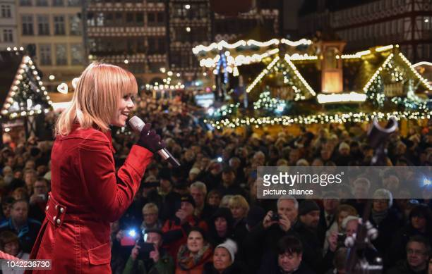 Swiss singer Francine Jordi sings at the opening of the traditional Christmas market on the Roemerberg square in Frankfurt am Main Germany 25...