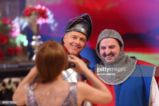 Swiss singer Francine Jordi takes a photograph of Presenter Joerg Pilawa and Austrian chef Johann Lafer at the final rehersal for the Silvestershow...