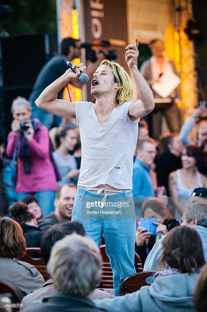 Swiss singer Tobias Jundt of Bonaparte performs live during a concert while interacting with the audience at Radio Eins Parkfest on August 27, 2014 in Berlin, Germany.
