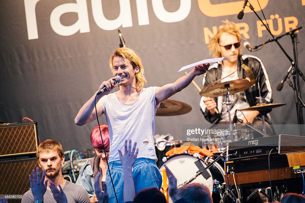 Swiss singer Tobias Jundt of Bonaparte reads the weather report live on air during a concert at Radio Eins Parkfest on August 27, 2014 in Berlin, Germany.