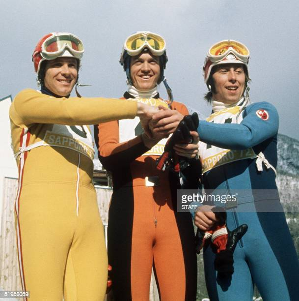Swiss skier Bernhard Russi is congratulated by his teammate Rolland Collombin and Austrian Heinrich Messner after winning the men's downhill 07...
